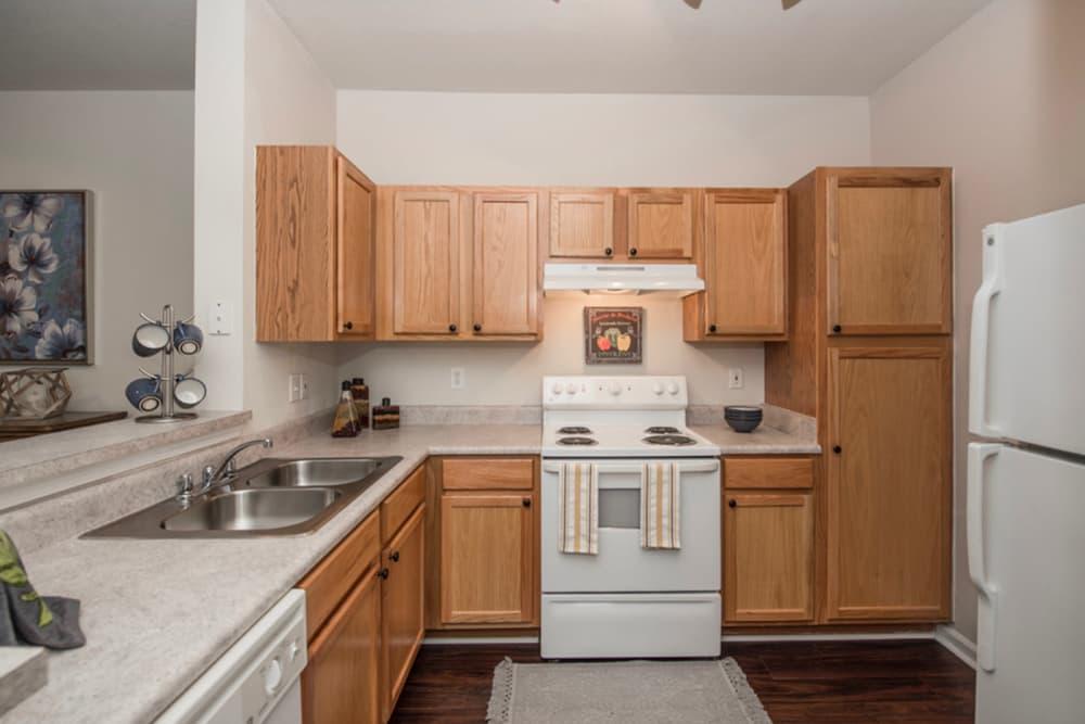 White kitchen appliances at Villas by the Lake in Jonesboro, Georgia
