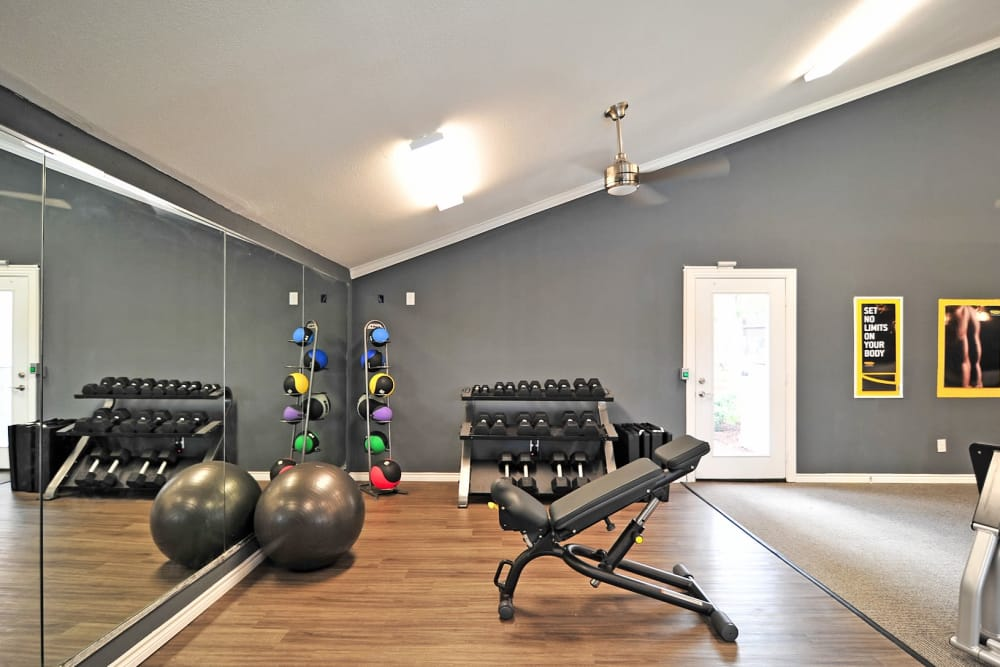 Fitness center at Bayou Parc at Oak Forest in Houston, Texas