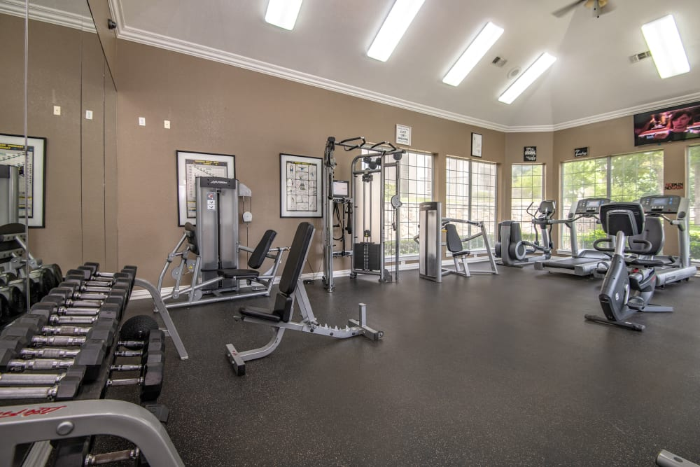 Spacious fitness center at Ballantyne Apartments in Lewisville, Texas