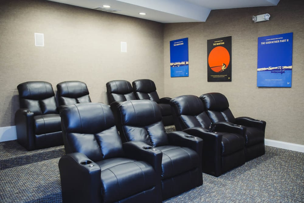 Leather chairs in the theater at Brighton Park Apartments in Byron, Georgia