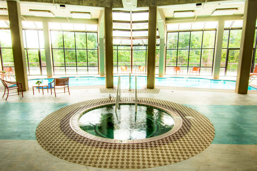 Resort-style hot tub and swimming pool at Woodland Heights in Little Rock, Arkansas