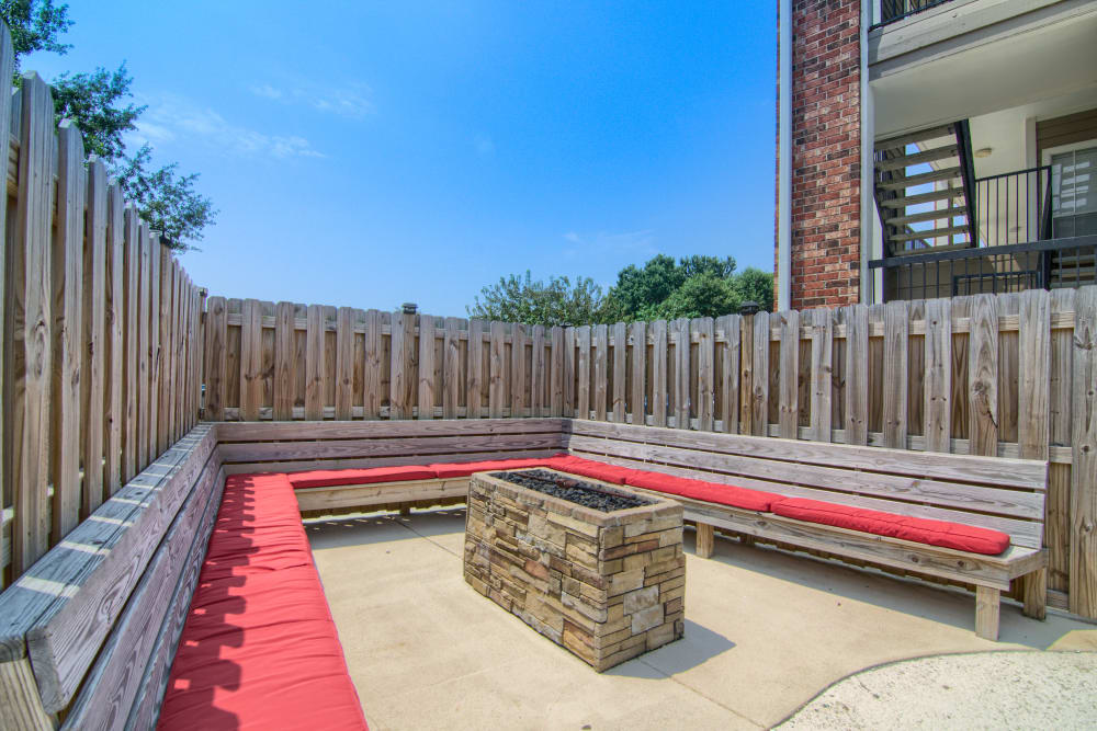 Fire-pit with benches at The Lexington Apartment Homes in Biloxi, Mississippi