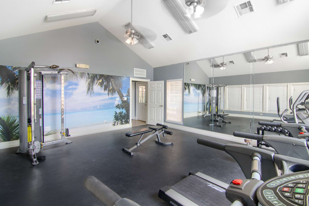 Fully-equipped fitness center at The Lexington Apartment Homes in Biloxi, Mississippi