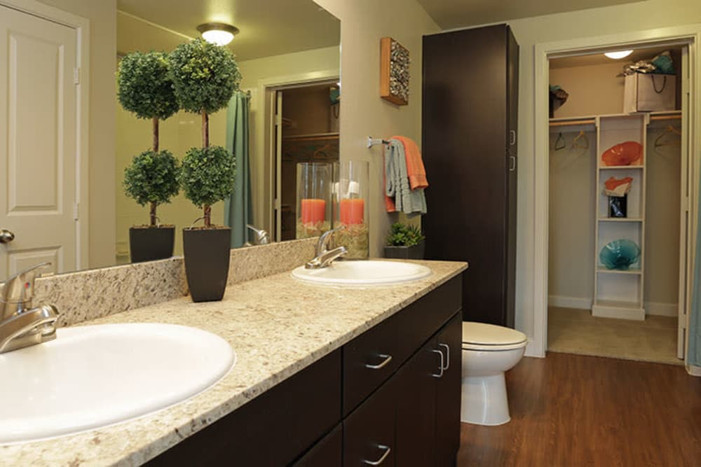 Bathroom with double sinks at Addison Keller Springs in Addison, Texas