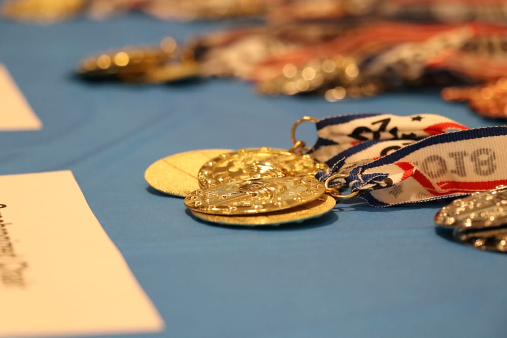 A table with medals at Discovery Senior Living in Bonita Springs, Florida