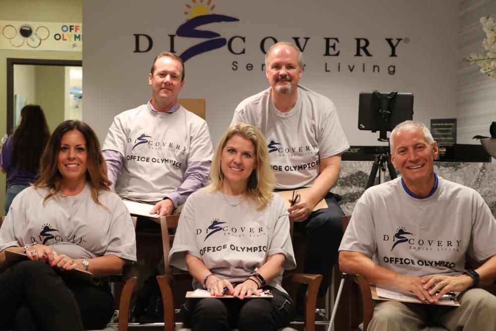 A group of people wearing the same shirts at Discovery Senior Living in Bonita Springs, Florida