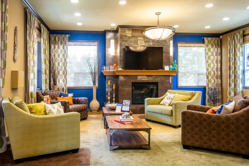 A living room that is great for entertaining at The Mill at Mill Creek Apartments in Mill Creek, Washington