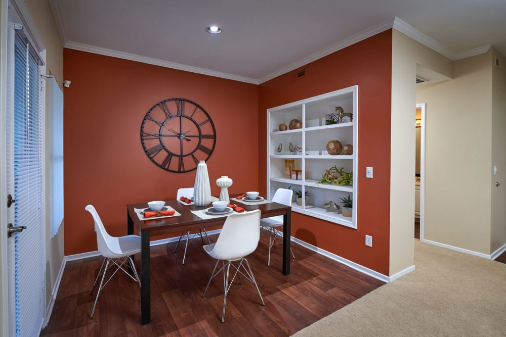 Dining room with wood-style flooring at Legend Oaks Apartments in Aurora, Colorado