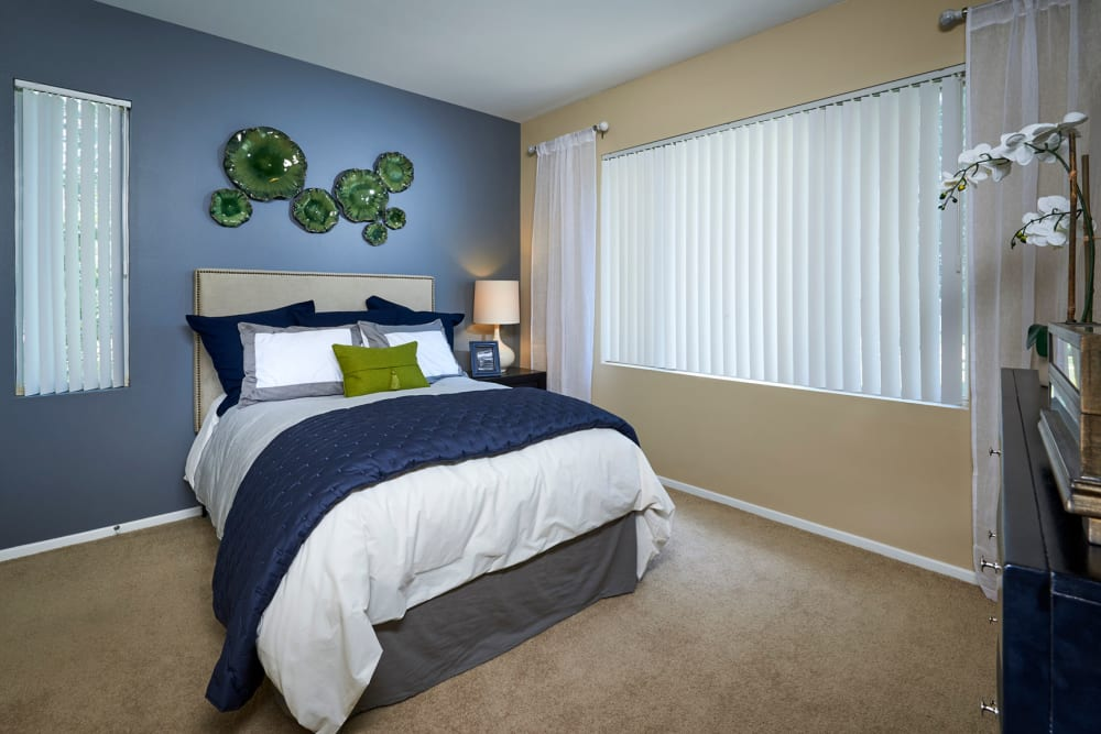 Master bedroom with a large window for natural lighting at Legend Oaks Apartments in Aurora, Colorado