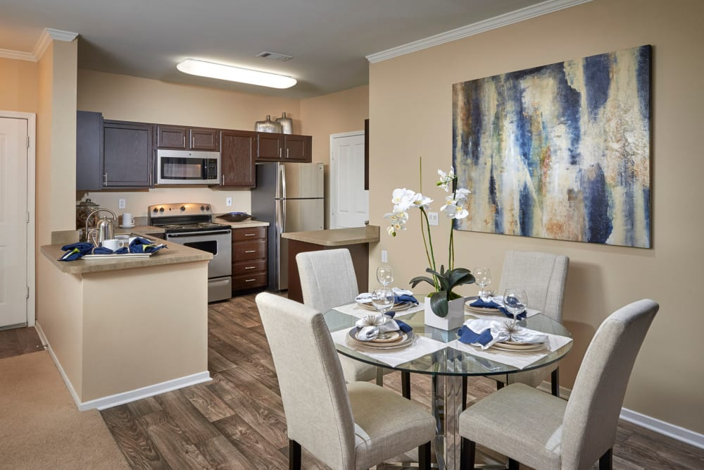 Kitchen overlooking the dining room at Legend Oaks Apartments in Aurora, Colorado
