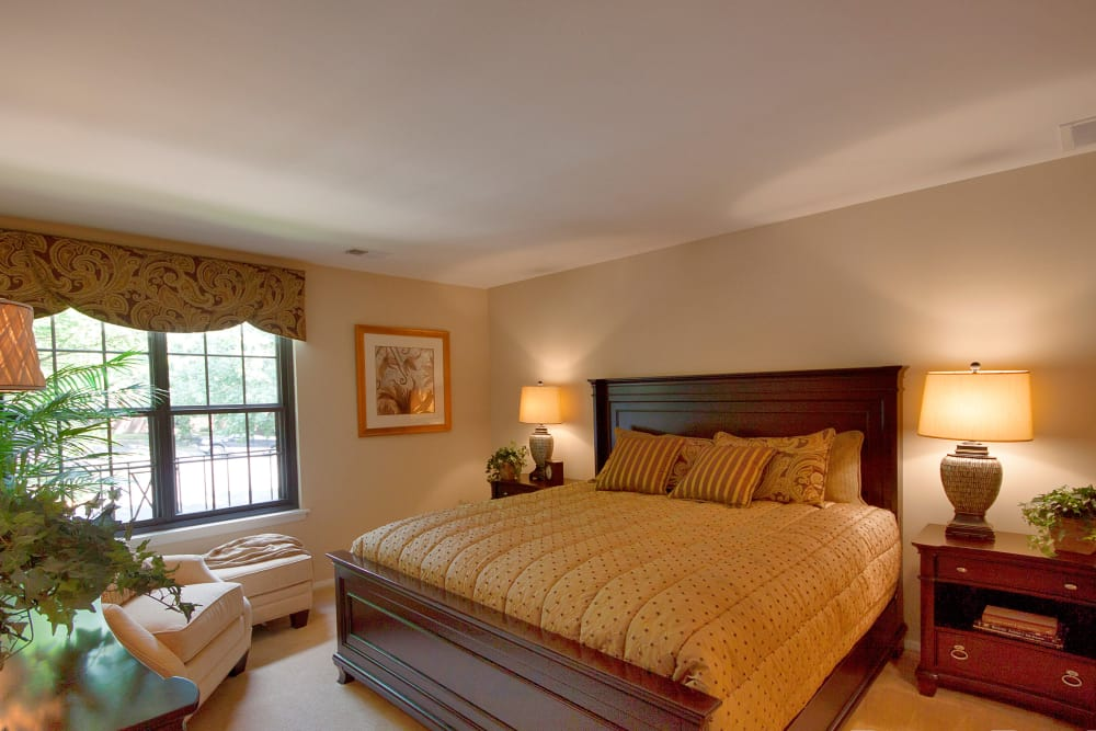 Modern bedroom at The Brittany Apartments in Pikesville, Maryland