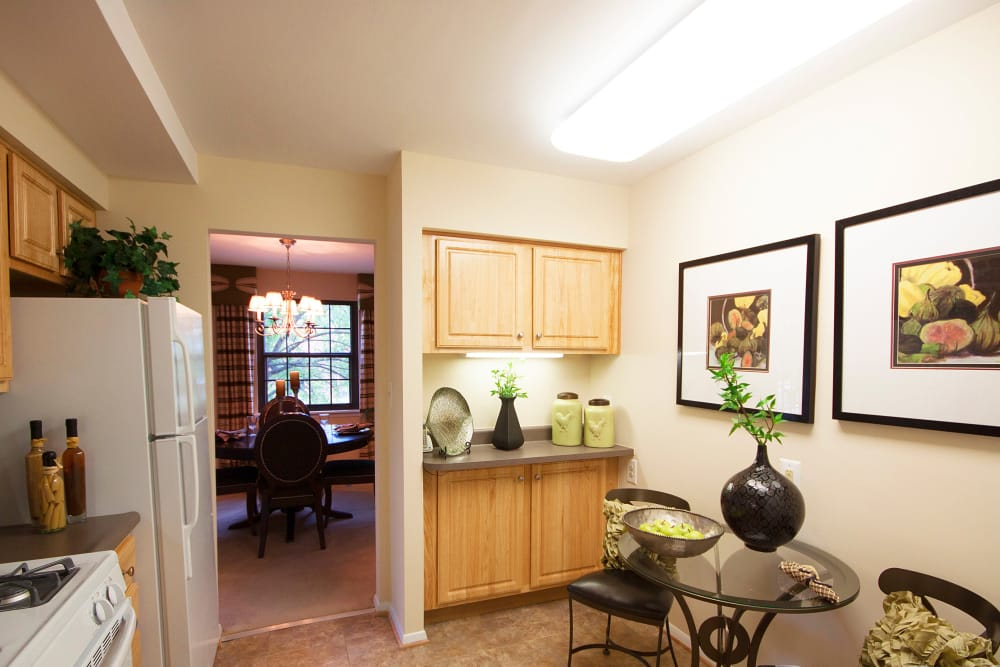 Kitchen and dining room at The Brittany Apartments in Pikesville, Maryland