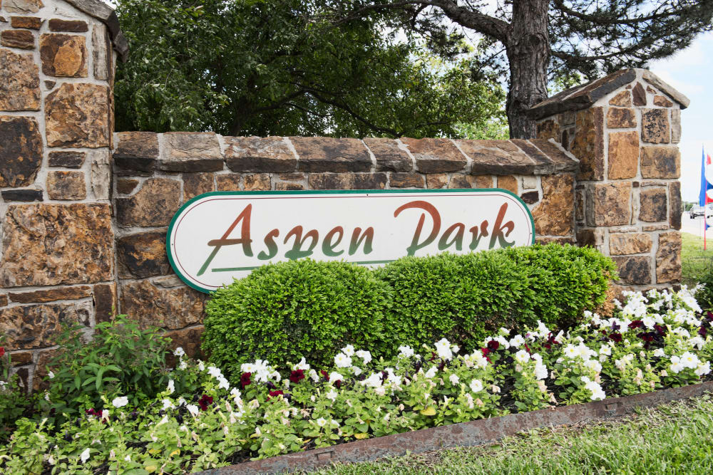 Welcome sign at Aspen Park Apartments in Wichita, Kansas