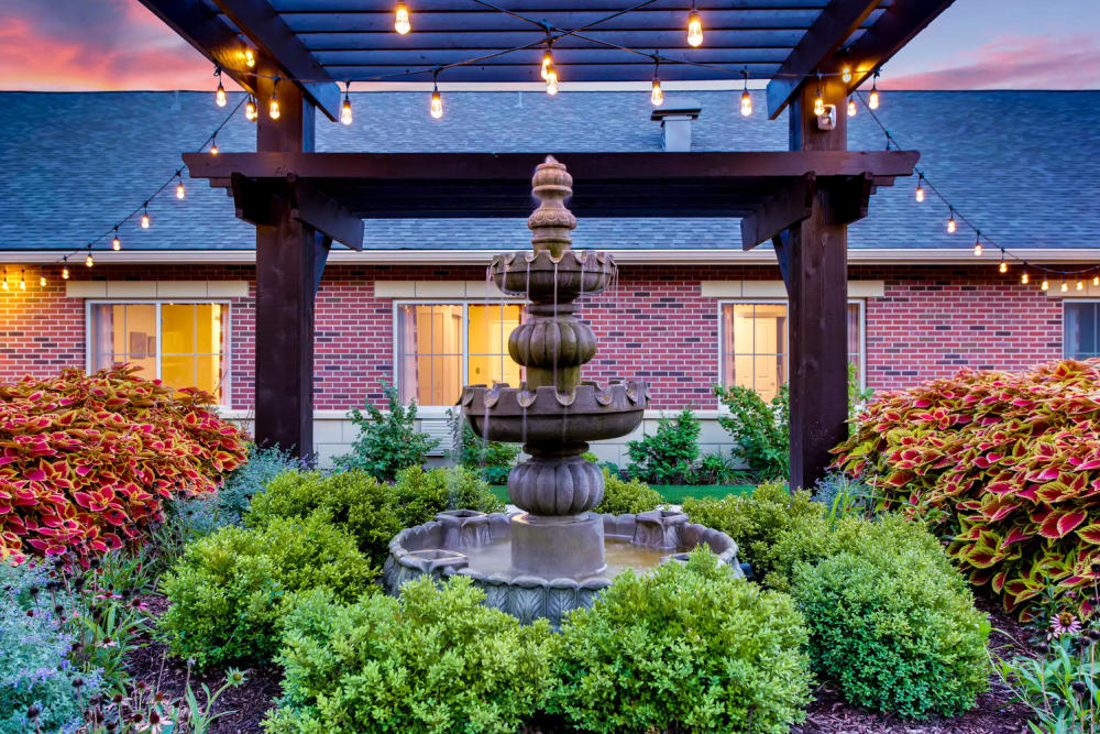 outdoor water fountain at Maple Glen Memory Care Community
