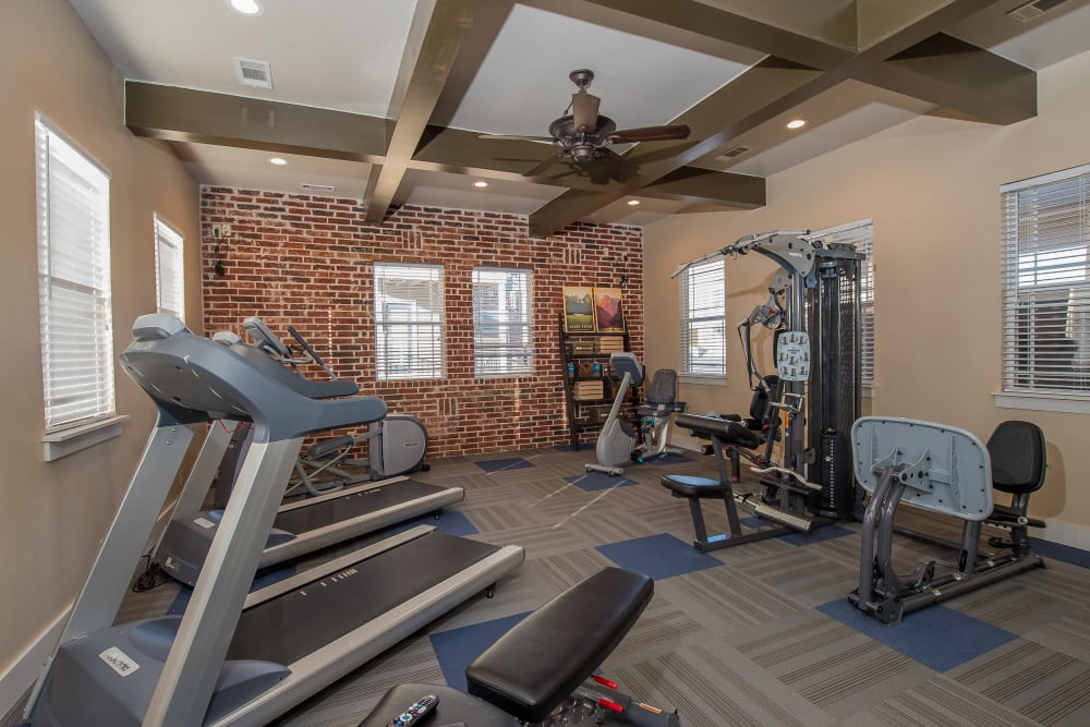 Fitness center at Cottages at Tallgrass Point Apartments in Owasso, Oklahoma