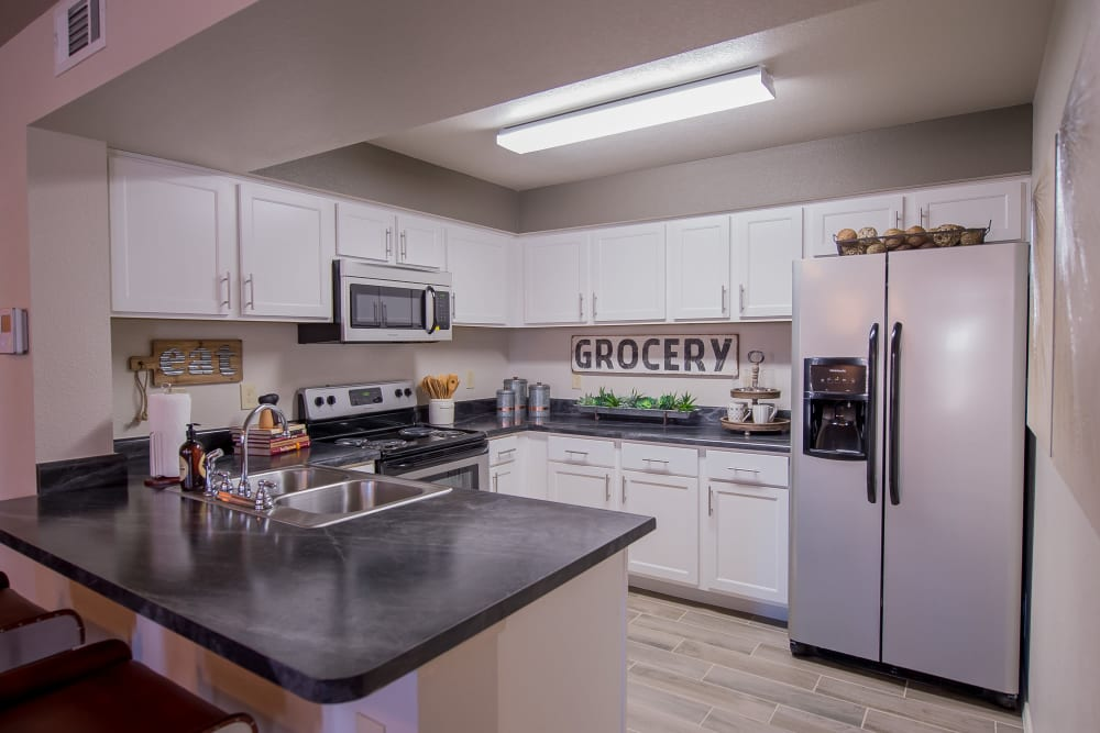 Kitchen at Cottages at Tallgrass Point Apartments in Owasso, Oklahoma
