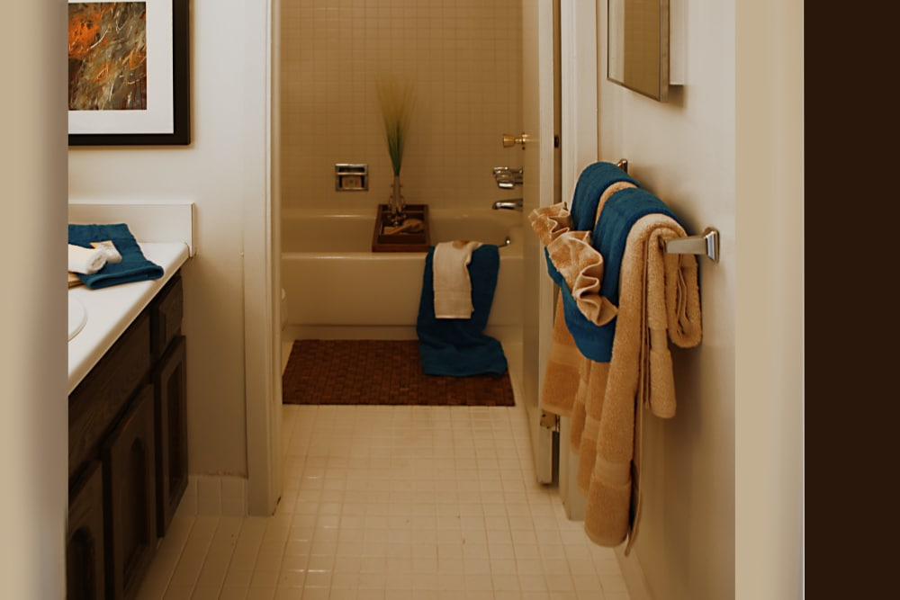 Spacious bathroom in model home at Kensington Manor Apartments in Farmington, Michigan
