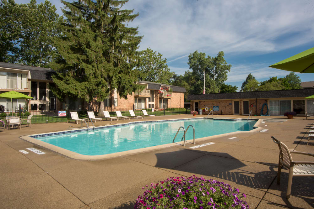 Swimming pool area at Kensington Manor Apartments in Farmington, Michigan