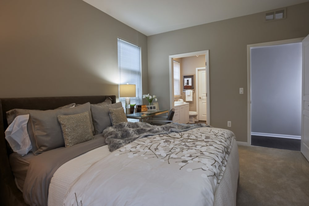 Richly furnished master bedroom in model home at Five Points in Auburn Hills, Michigan