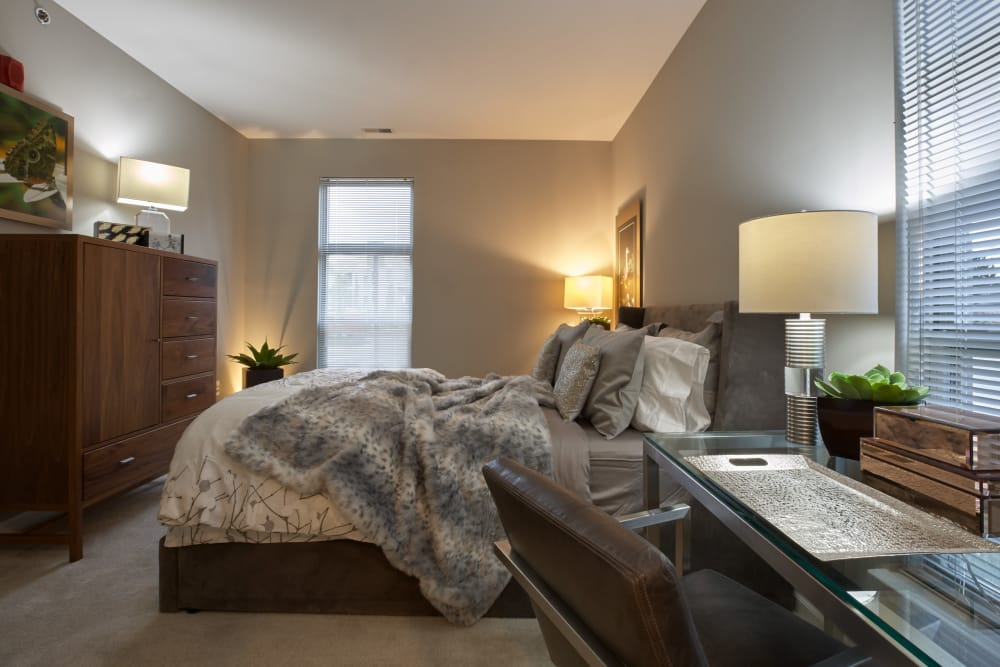 Luxurious furnishings in spacious bedroom of model home at Five Points in Auburn Hills, Michigan