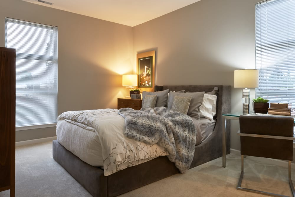 Wide view of well-decorated master bedroom in model home at Five Points in Auburn Hills, Michigan