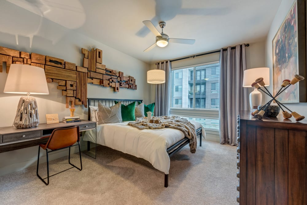 Well decorated bedroom at Aura 5515 in Dallas, Texas
