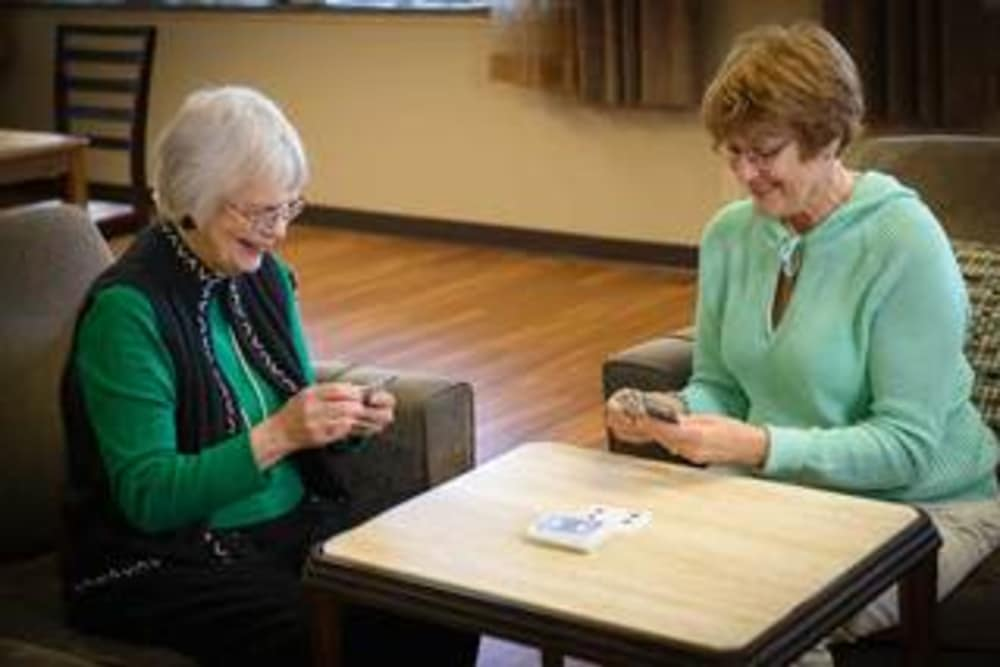 Women at Ramsey Village Continuing Care strategically play cards in Des Moines, Iowa