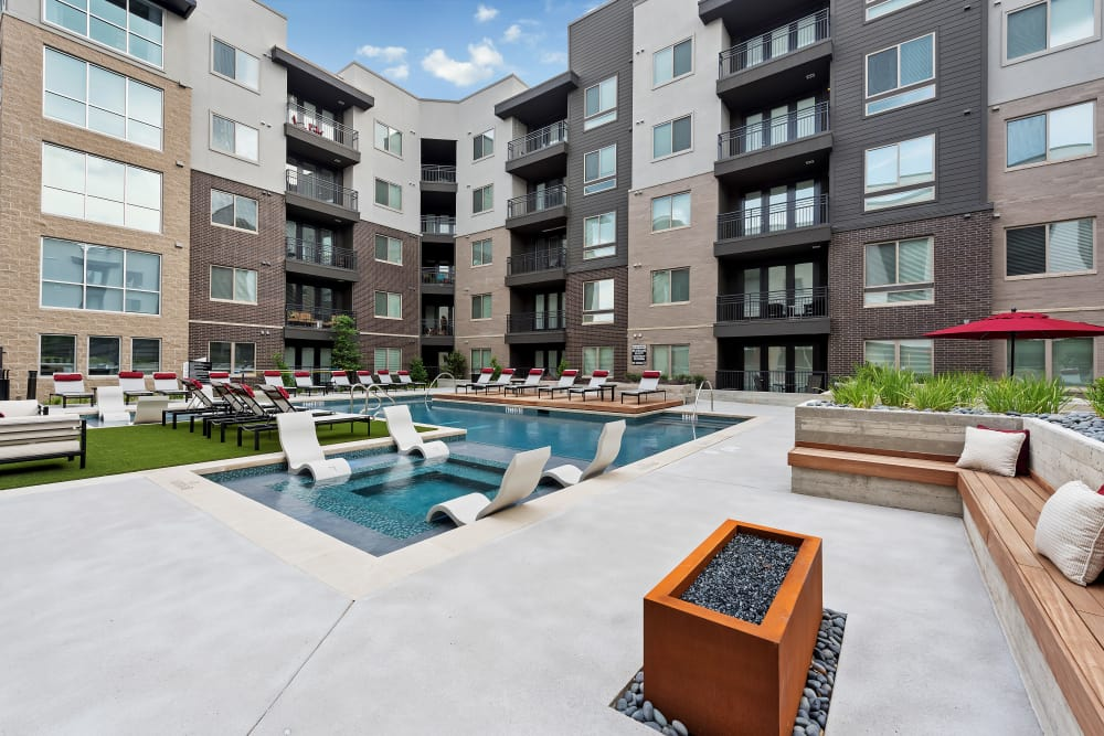 Modern community area near to the swimming pool at Aura 5515 in Dallas, Texas