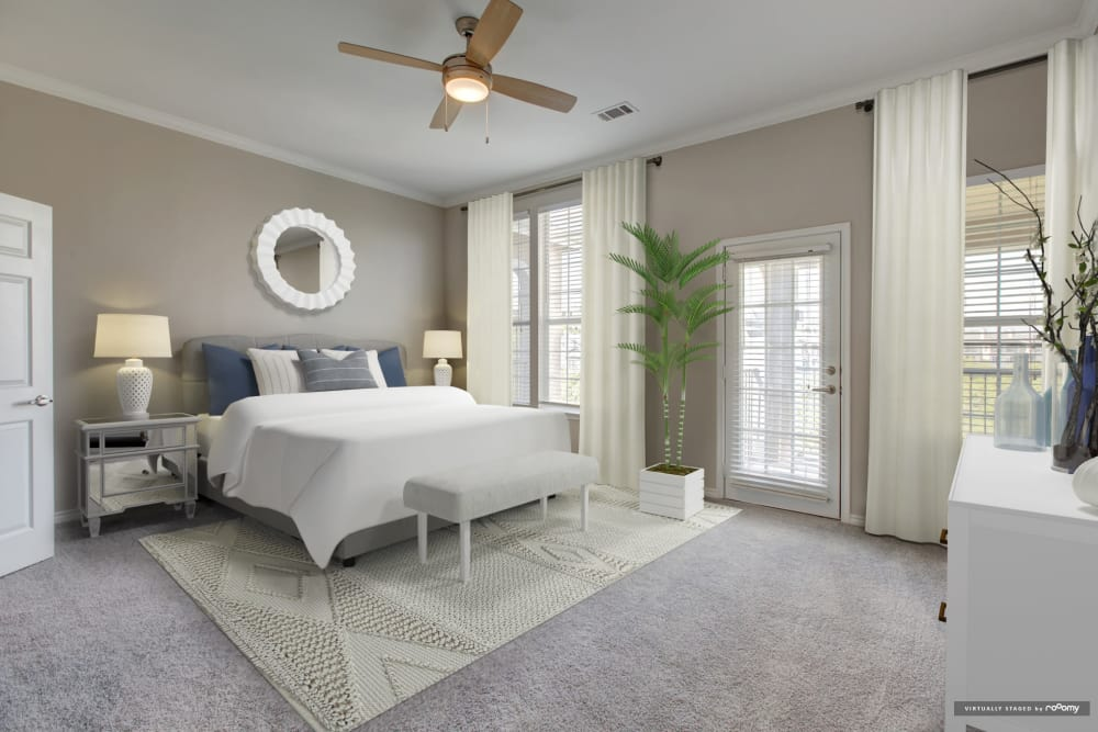 Natrually well-lit bedroom at Meritage at Steiner Ranch in Austin, Texas