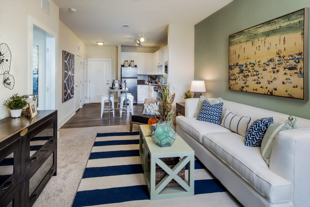 Living room and dining room at BluWater Apartments in Jacksonville Beach, Florida
