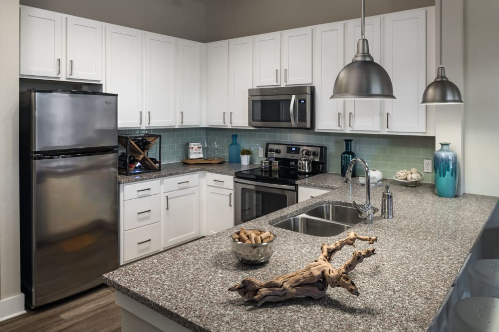 Fully equipped kitchen at BluWater Apartments in Jacksonville Beach, Florida
