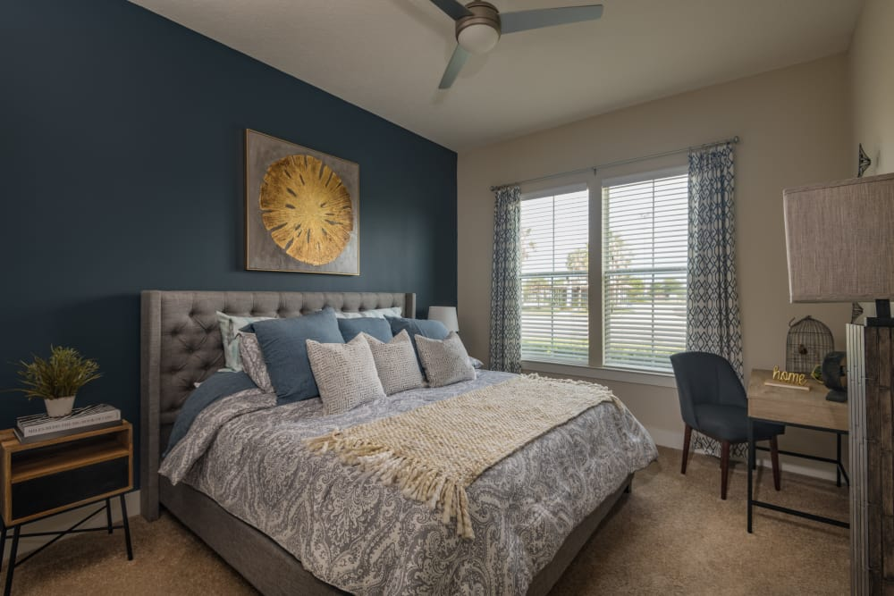 Modern bedroom at BluWater Apartments in Jacksonville Beach, Florida