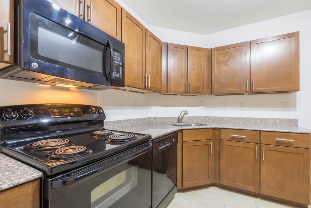 Fully equipped kitchen at The Square at Mason Mill Apartments in Decatur, Georgia