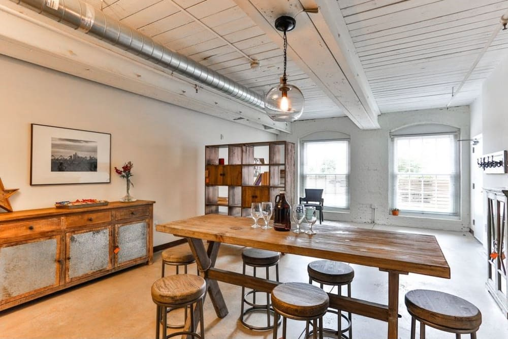 Living room and dining room at Highland Mill Lofts in Charlotte, North Carolina