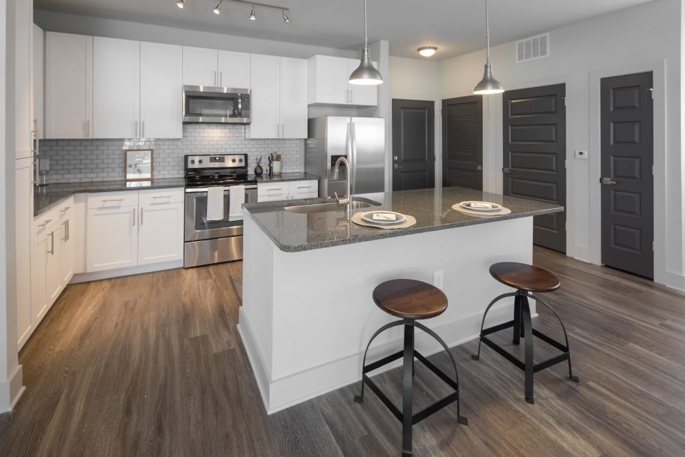 Breakfast bar and kitchen at Leigh House Apartment Homes in Raleigh, North Carolina