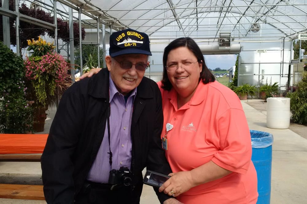 A veteran resident posing for a photo with a caretaker at Forest Springs Health Campus in Louisville, Kentucky