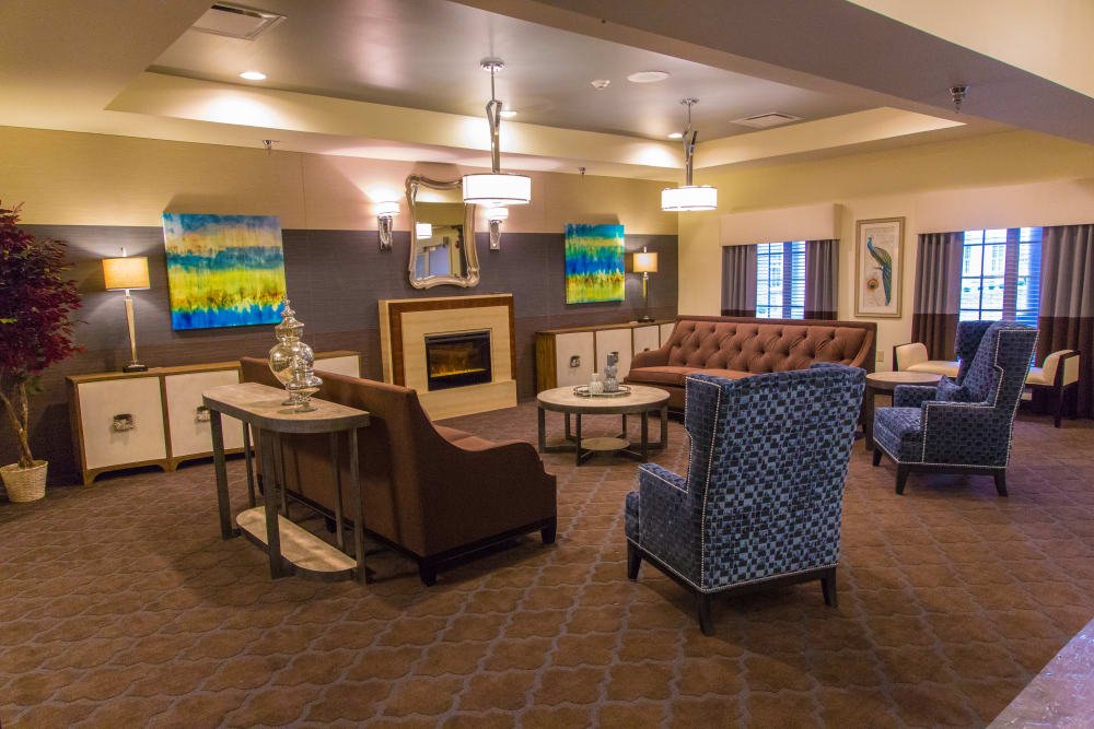 Comfortable fireside seating in the lounge at Forest Springs Health Campus in Louisville, Kentucky