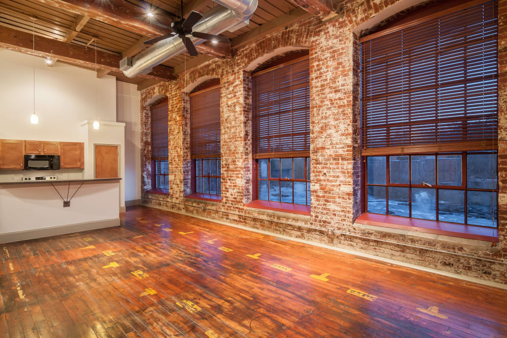 Spacious living room and kitchen at Porterdale Mill Lofts in Porterdale, Georgia