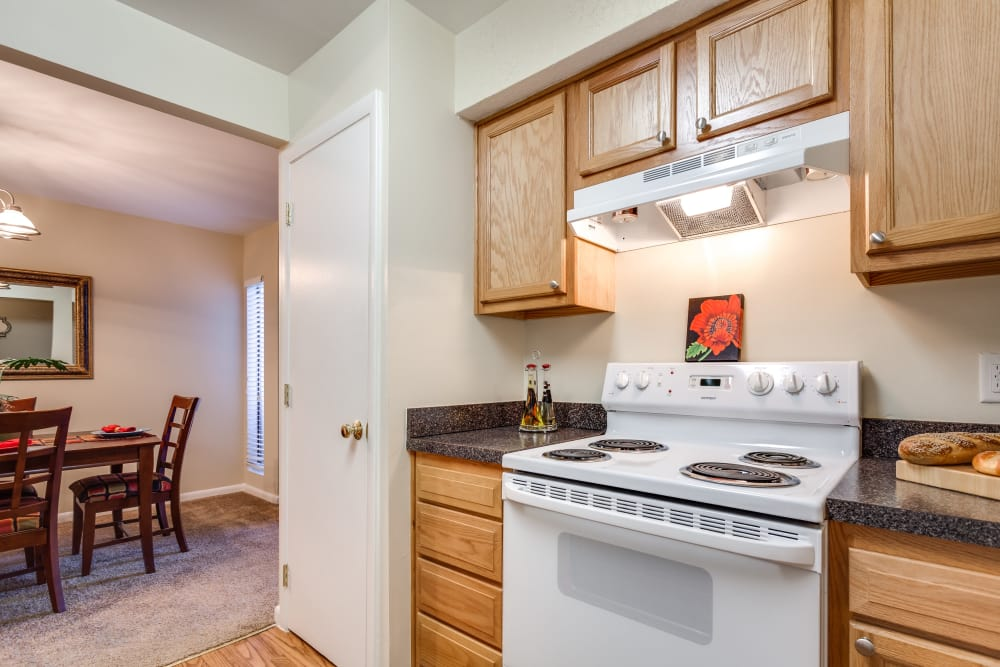 Fully equipped kitchen at Villages of Lake Boone Trail in Raleigh, North Carolina