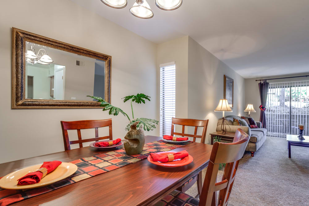 Dining room and living room at Villages of Lake Boone Trail in Raleigh, North Carolina