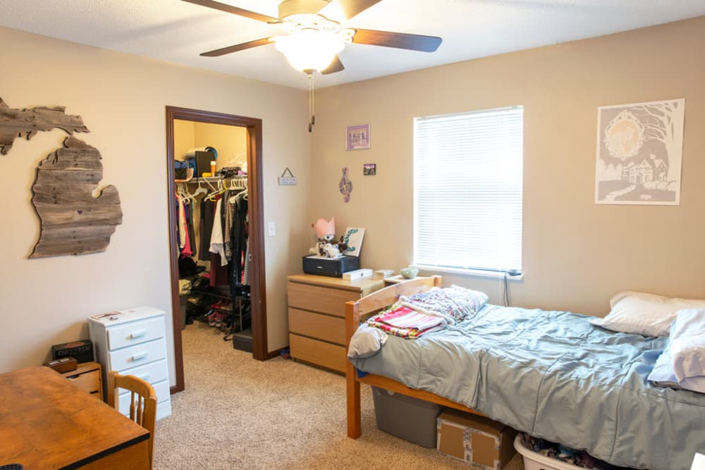 Bedroom with a walk-in closet at South Maple in Ames, Iowa