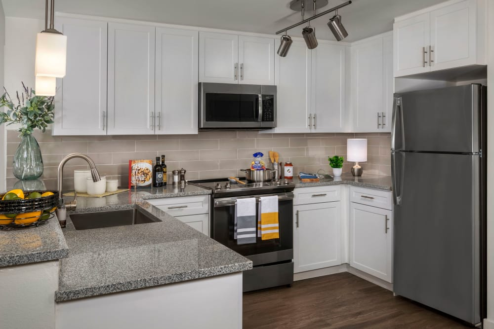 Kitchen with hardwood floors and stainless steel appliances at Clearwater at Riverpark in Oxnard, California