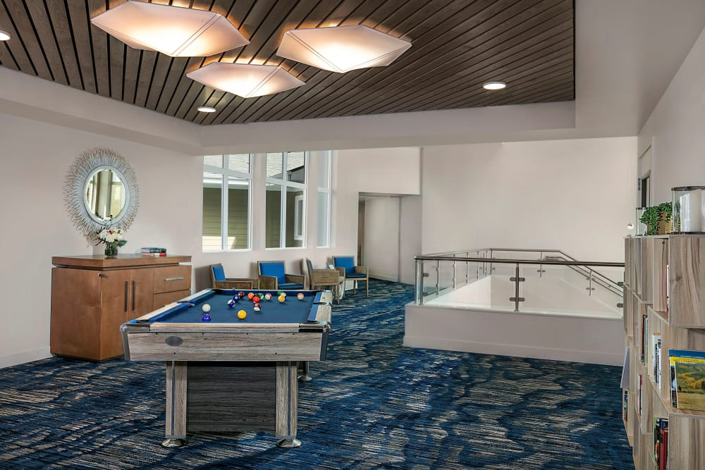 Lounge room with a pool table at Clearwater at Riverpark in Oxnard, California