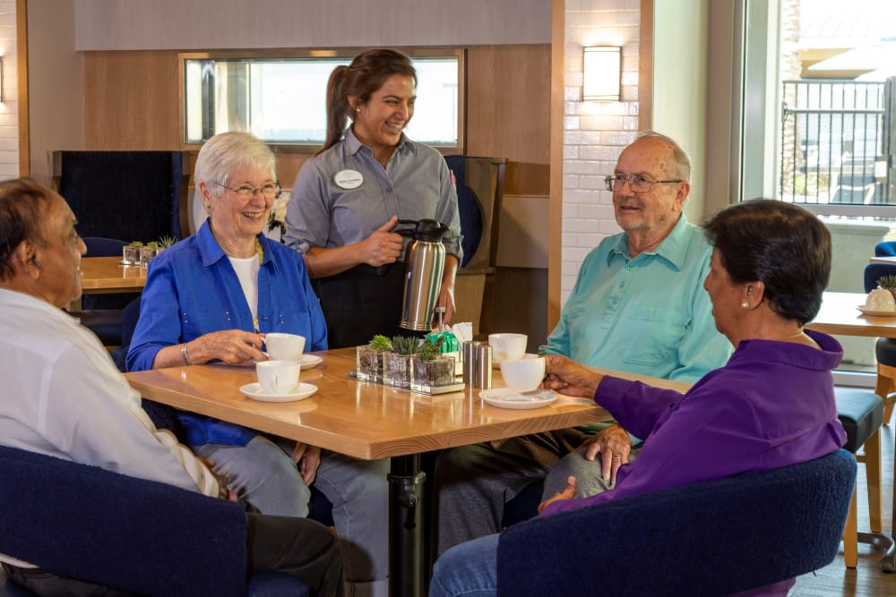 Residents enjoy a meal together in the dinning area at Clearwater at Riverpark in Oxnard, California