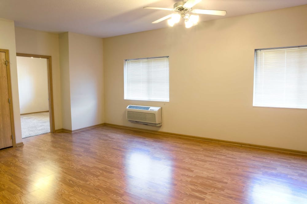 Wood flooring in the dining room and living room at Crown Point Apartments in Ames, Iowa