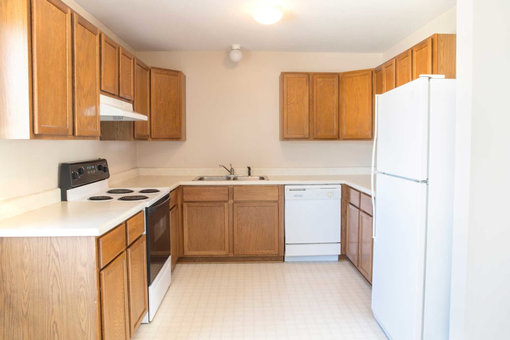 Large kitchen with plenty of counter space at Crown Point Apartments in Ames, Iowa