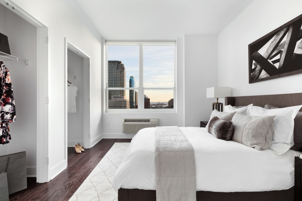 Master bedroom with city view from the window in Jersey City, New Jersey at Trump Bay Street