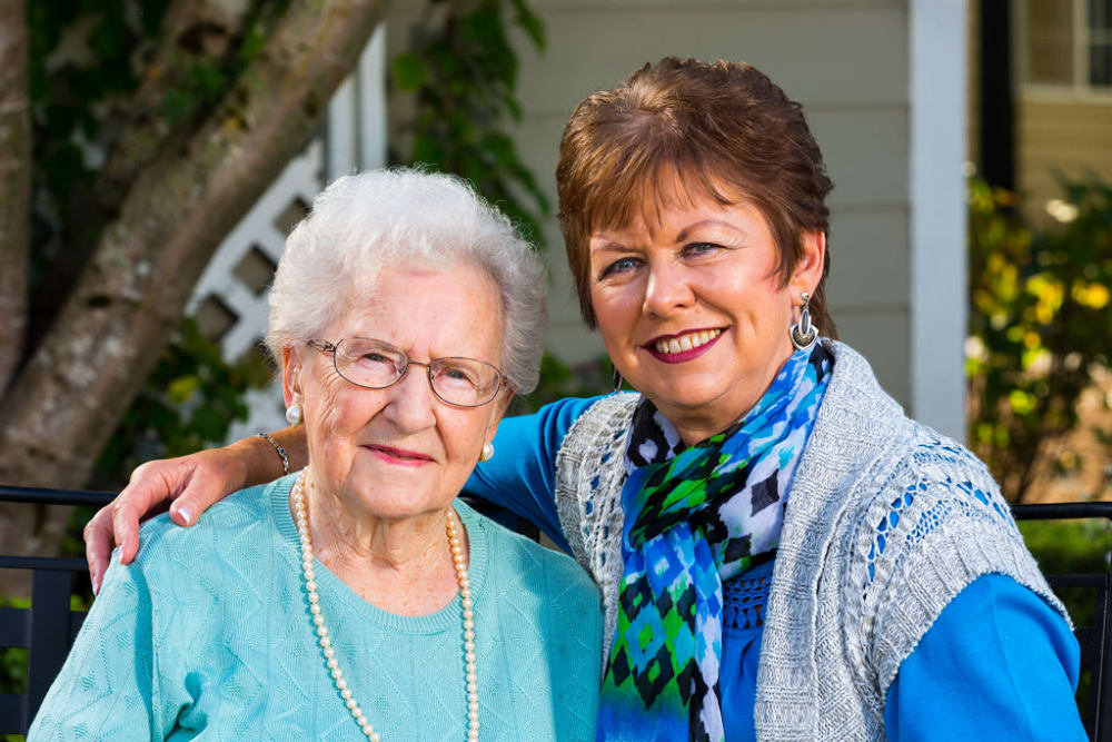 two elderly women smiling
