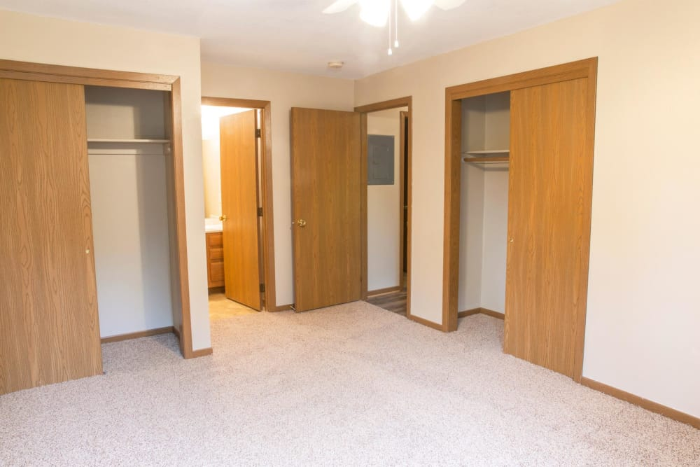 A bedroom with two closets and an attached bathroom at Stone Court in Ames, Iowa