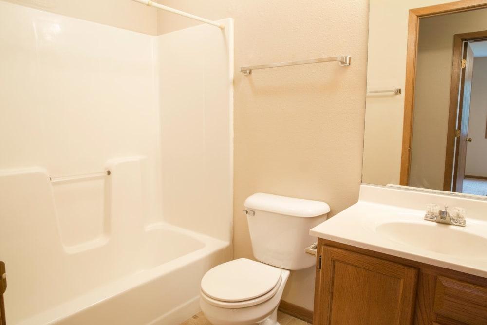 An apartment bathroom with a bathtub at Stone Court in Ames, Iowa